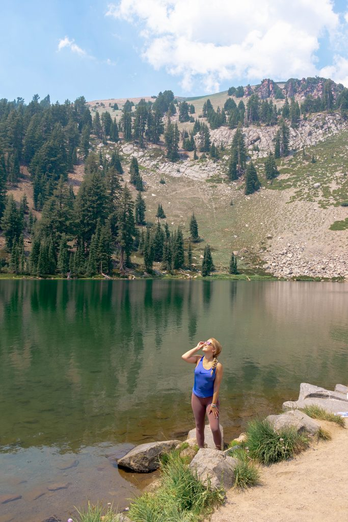 A woman enjoying lake views in Lassen Volcanic National Park