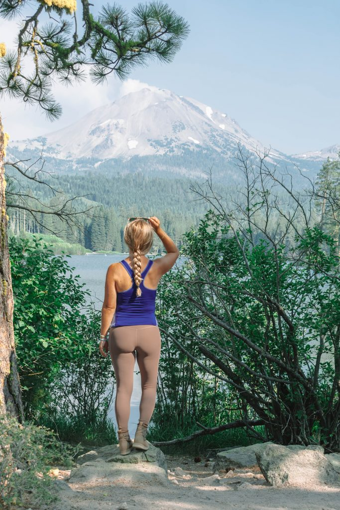 A woman enjoying the beautiful views at Manzanita Lake in Lassen Volcanic National Park