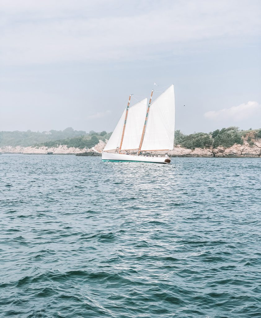 A sailboat on the Narragansett Bay during summer in Newport, RI