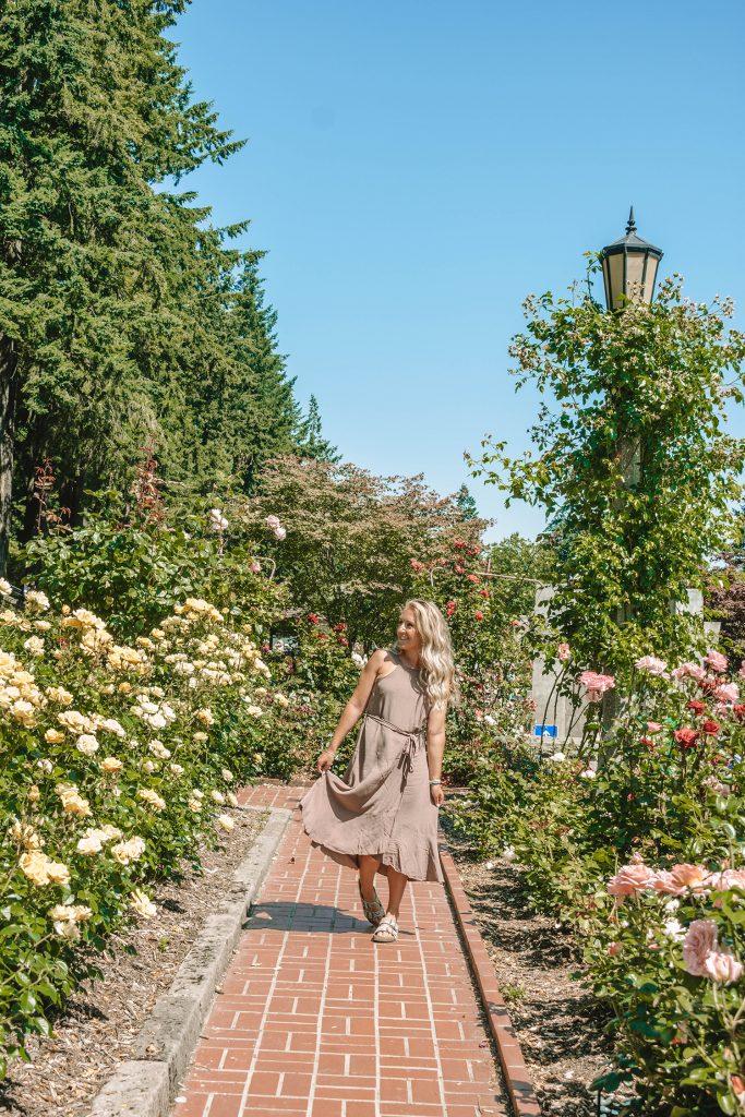 A woman walking through the Portland Rose Garden
