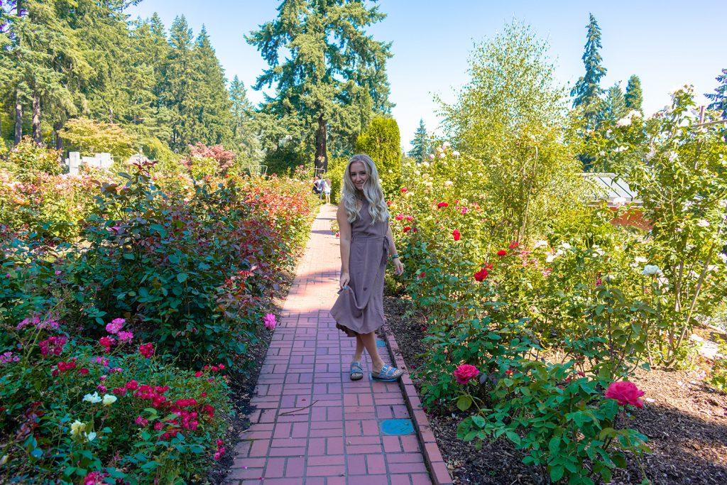 A woman walking through the Portland Japanese Garden