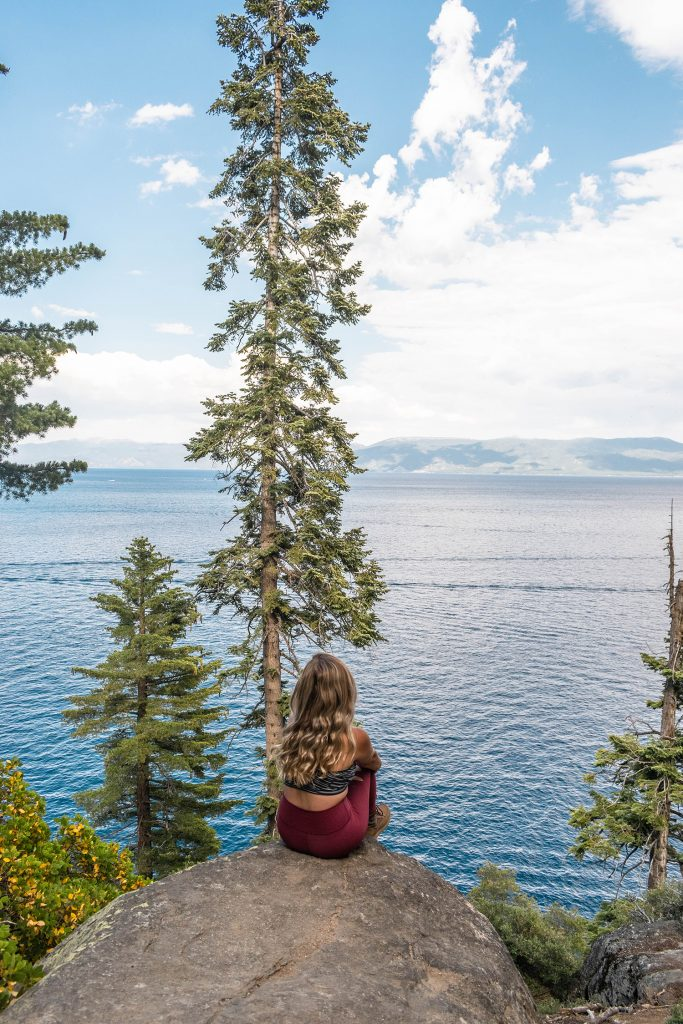 A woman enjoying views of Lake Tahoe from the Rubicon Trail