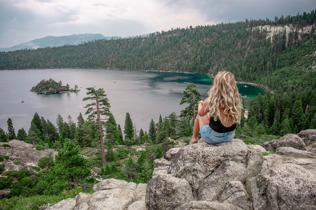 A woman enjoying views of Emerald Bay State Park in Tahoe, California