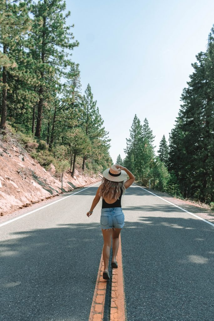 A woman running down a road in Tahoe
