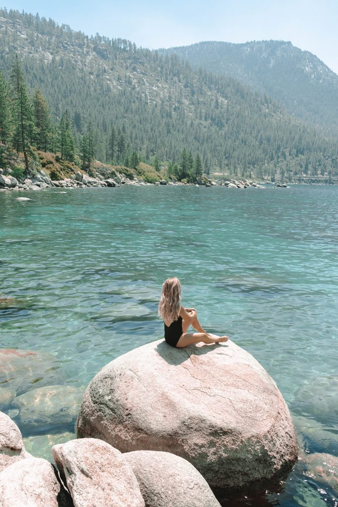 A woman at a hidden swimming spot in Lake Tahoe's Nevada side