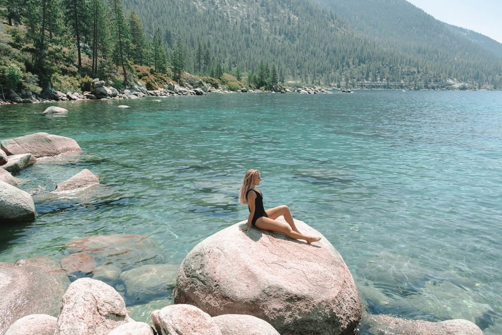A woman enjoying Lake Tahoe during a Northern California and Oregon Road Trip