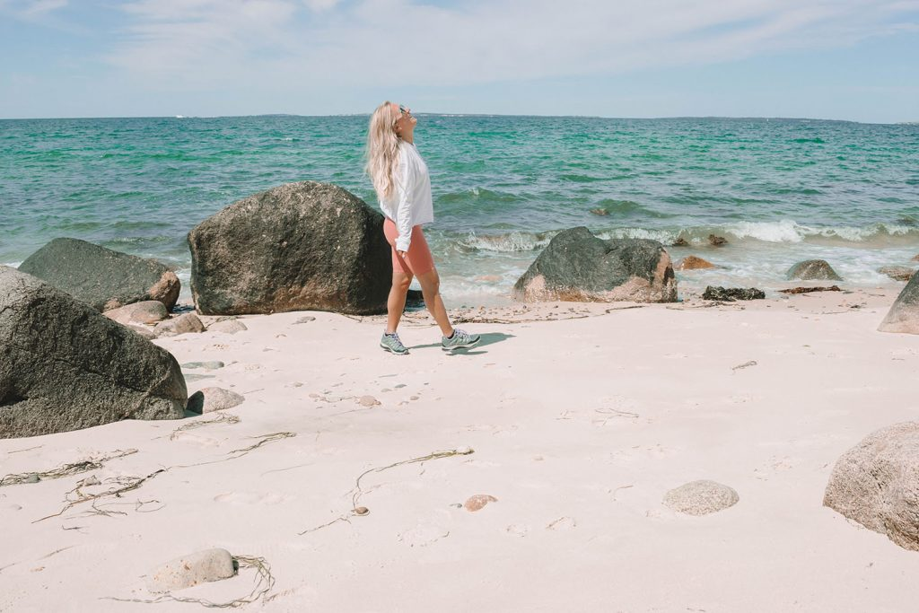 A woman strolling the beach at Great Rock Bight Preserve