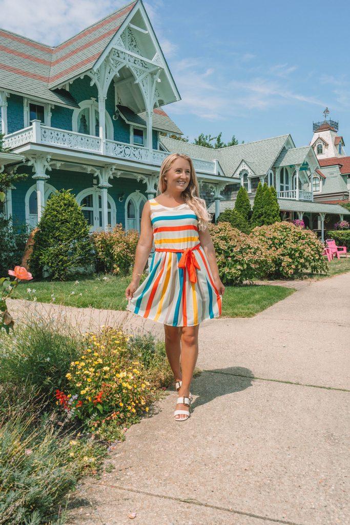 A woman in a rainbow striped dress in Oak Bluffs