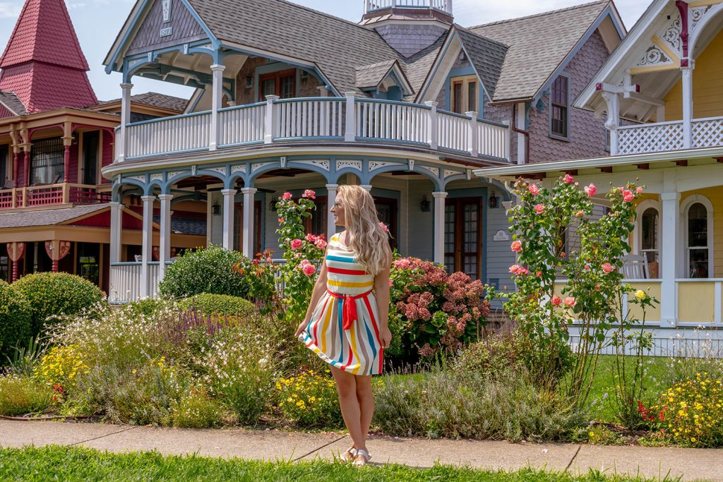 A woman in front of the Gingerbread Houses in Oak Bluffs