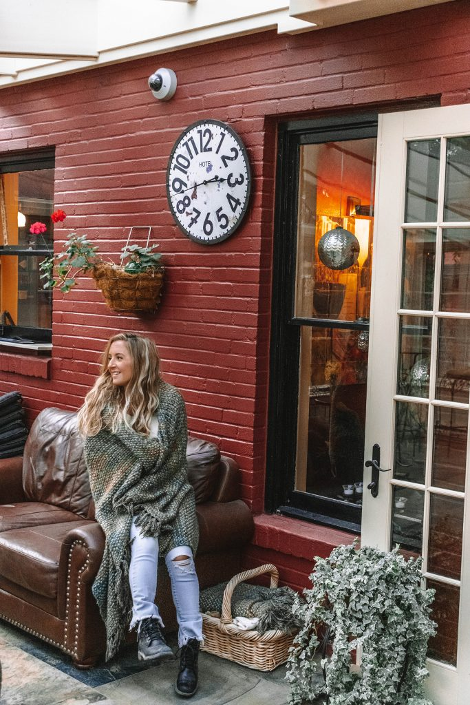 A woman cozying up at Chamberlin Inn in Cody, Wyoming