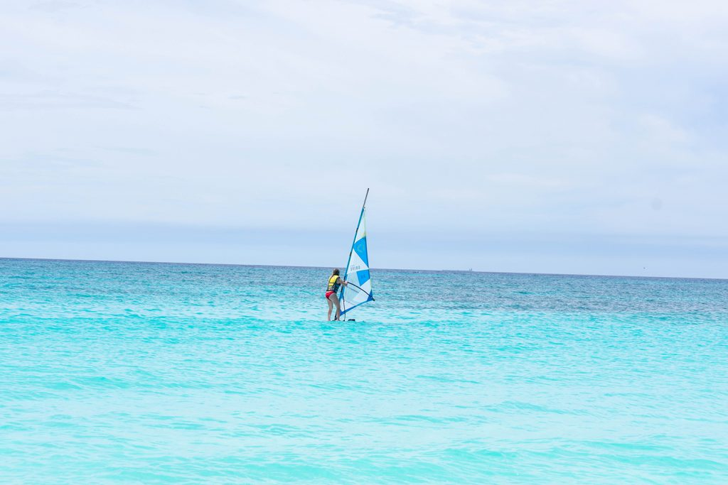 A woman windsurfing in the Caribbean Sea