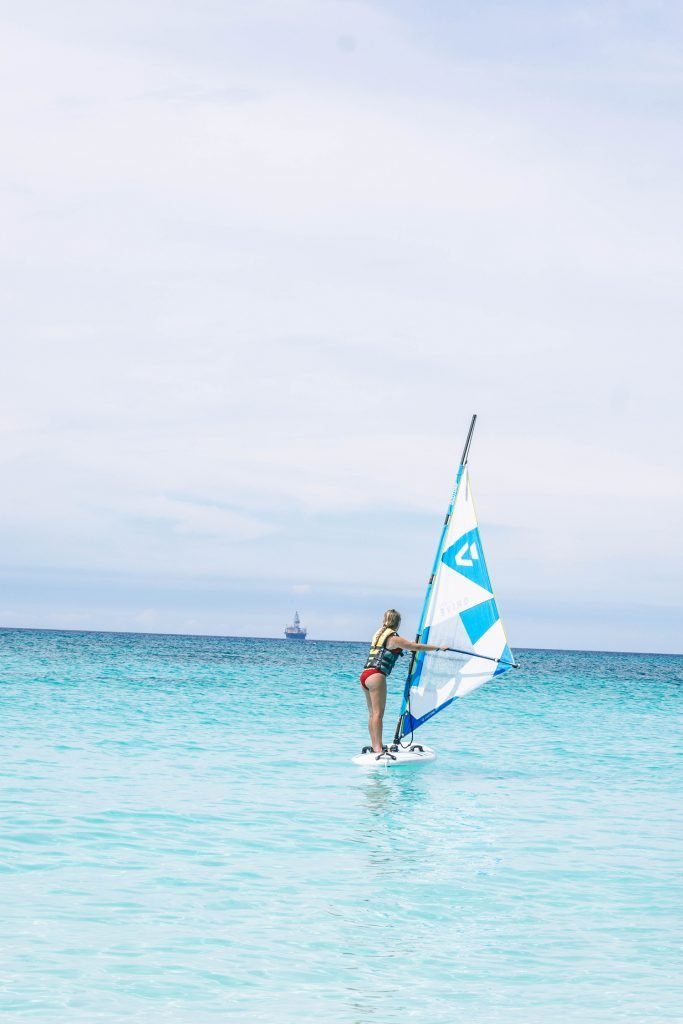 A woman windsurfing at Divi All Inclusive Aruba