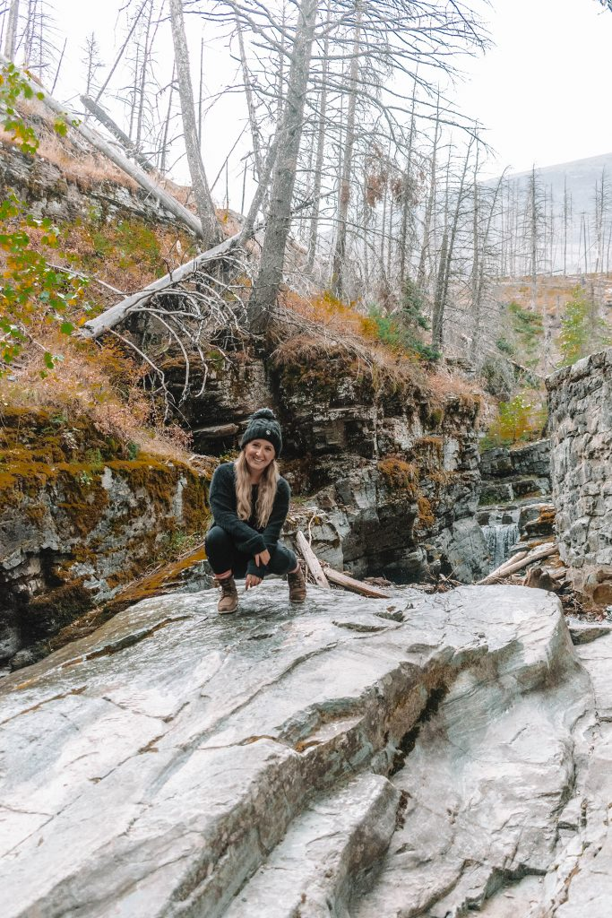 A woman at Sunrift Gorge in Glacier National Park