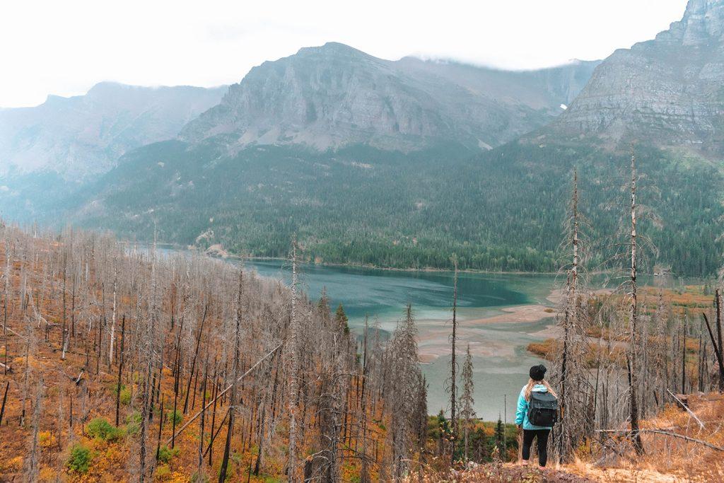 A woman enjoying beautiful lake views during the best Montana road trip