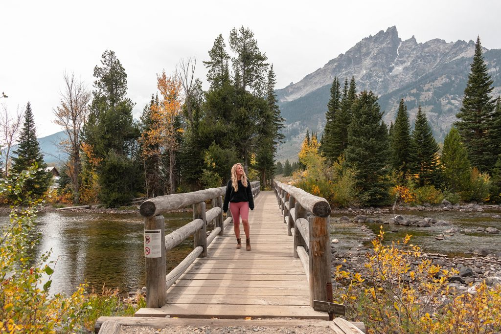 A woman enjoying her time in Grand Teton National Park during her Yellowstone and Grand Teton itinerary
