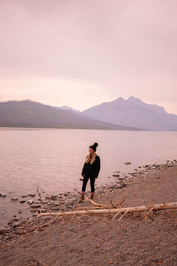 A woman enjoying sunrise at Lake McDonald in Glacier National Park