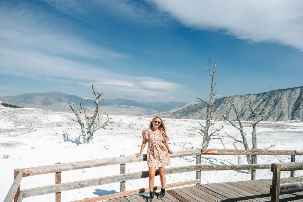 A woman enjoying her time in Yellowstone National Park at Mammoth