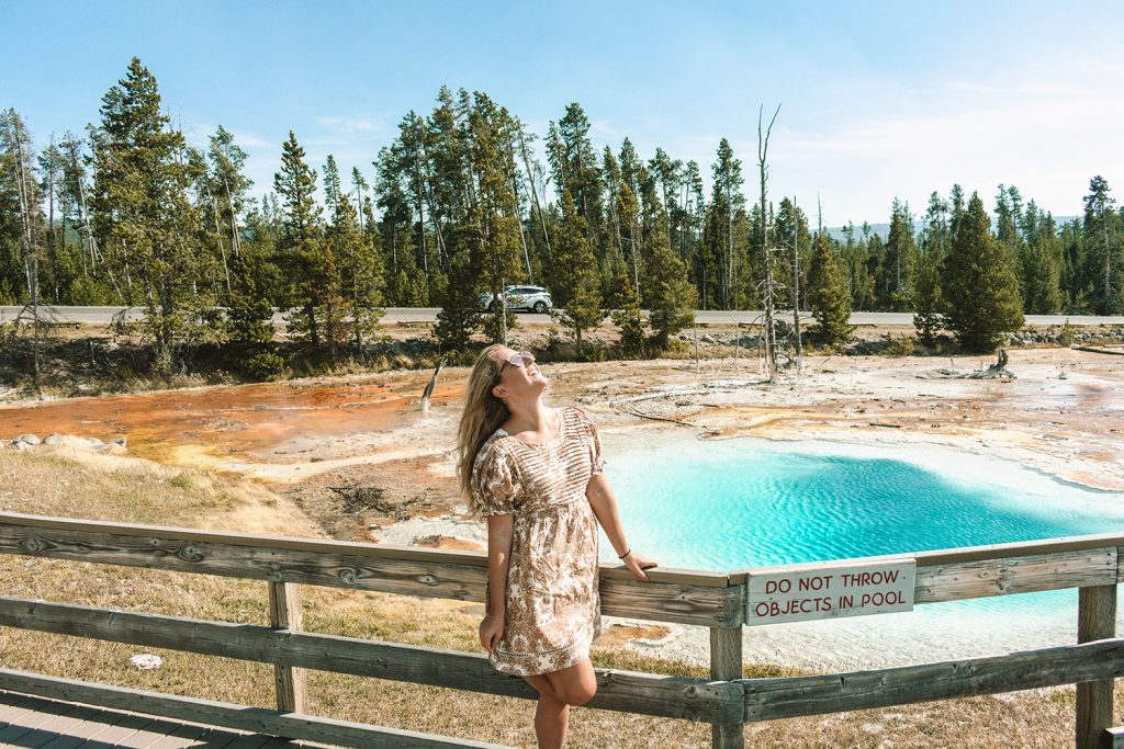 A woman enjoying her time at Yellowstone National Park