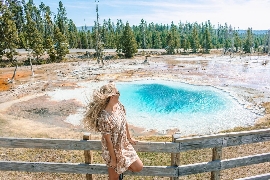 A woman enjoying her Yellowstone and Grand Teton itinerary in Wyoming