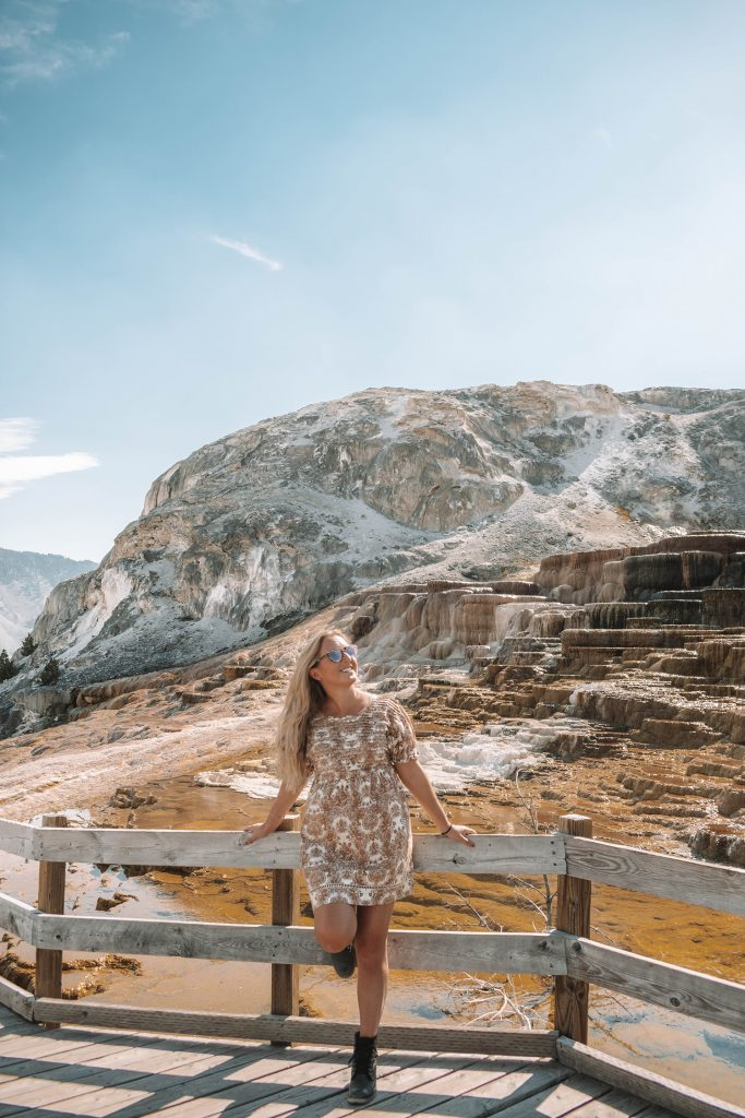 A woman enjoying Mammoth Hot Springs in Yellowstone National Park