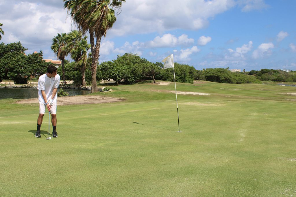 A man playing golf at The Links at Divi Aruba