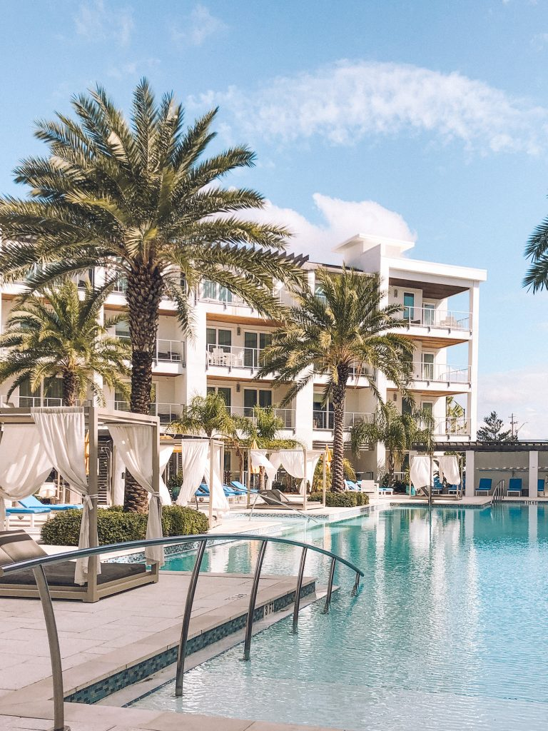 A luxury condo with a pool and cabanas at Inlet Beach