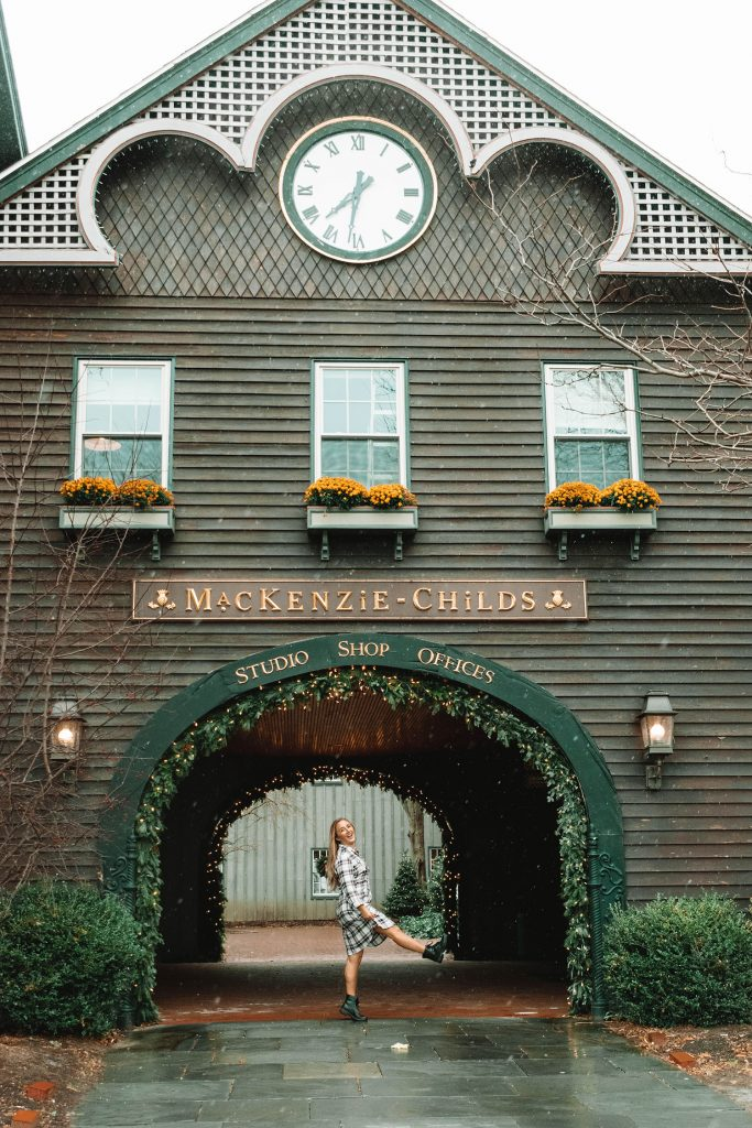 A woman standing in front of MacKenzie-Childs in the Finger Lakes