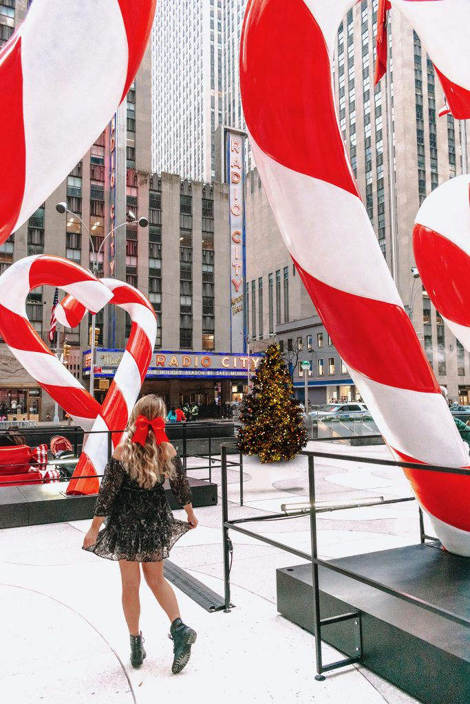 A woman admiring the candy canes in NYC