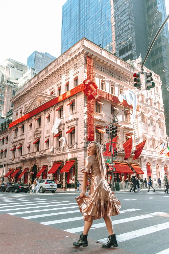 A woman in front of Cartier during the holiday season