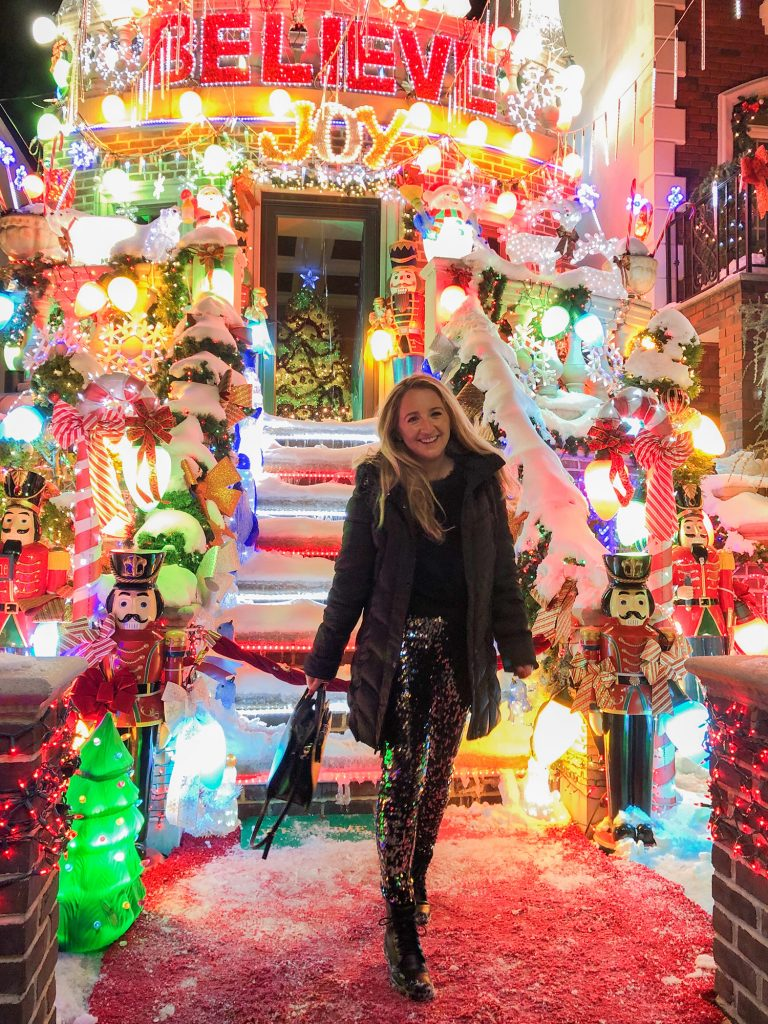 A woman seeing Christmas lights at Dyker Heights in Brooklyn