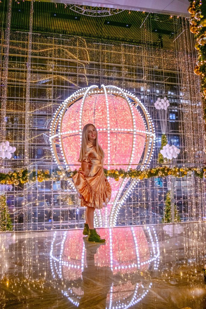 A woman experiencing the holiday magic at Hudson Yards - one of the top 40 things to do in NYC