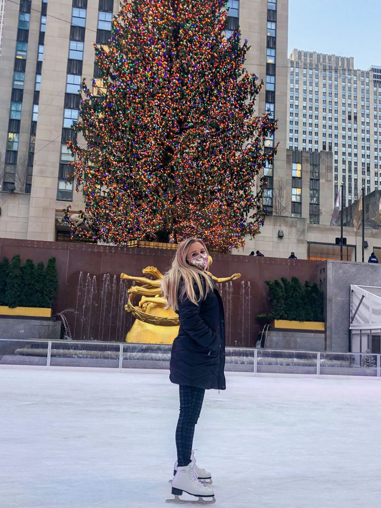 A woman ice skating at The Rink at Rockefeller Center