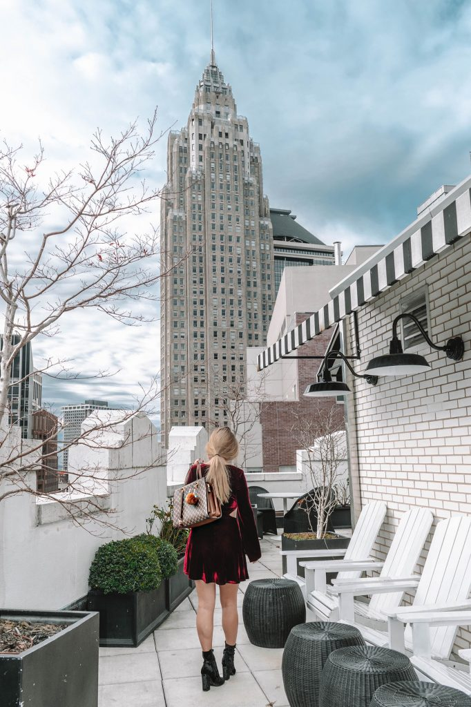 A woman on a Sonder rooftop in NYC