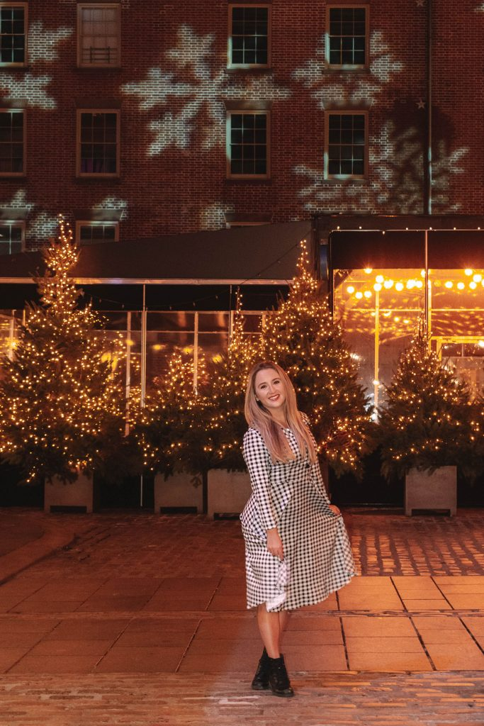 A woman enjoying the holiday decorations at South Street Seaport