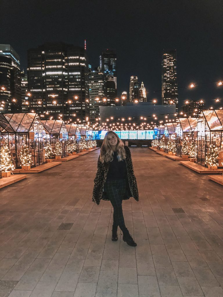 A woman enjoy The Greens Rooftop at Pier 17 in 2020