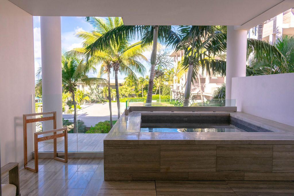 A plunge pool outside of a hotel room at Four Seasons Anguilla