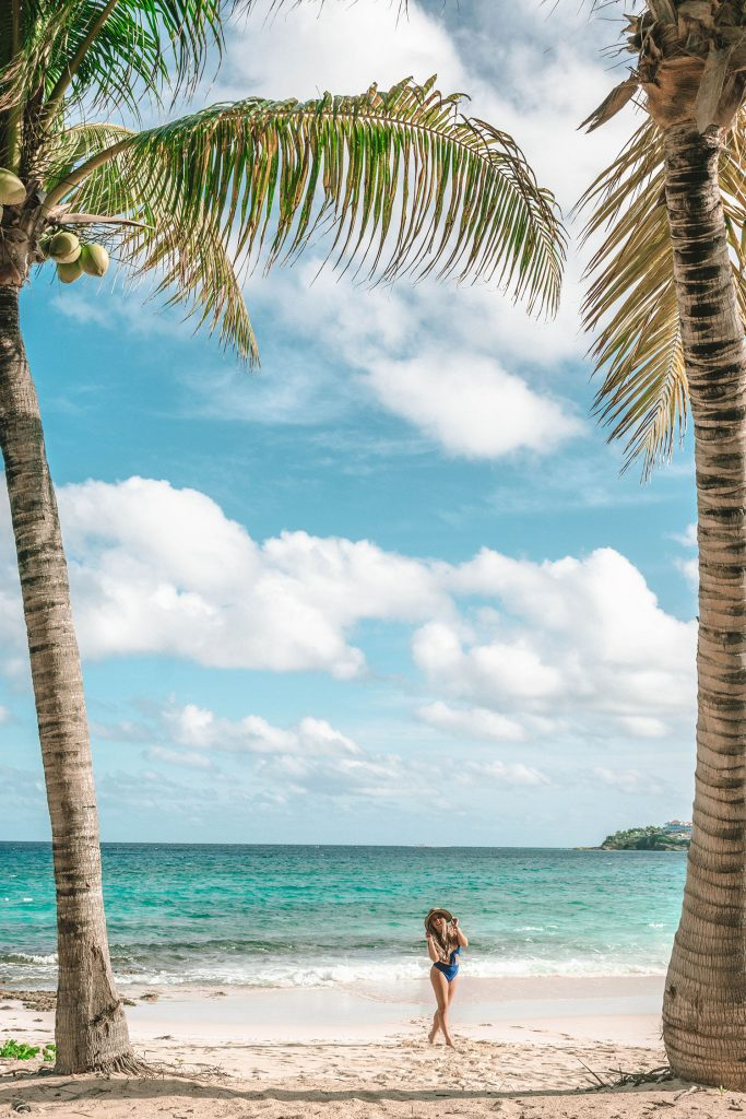 A woman enjoying a beach day in Anguilla