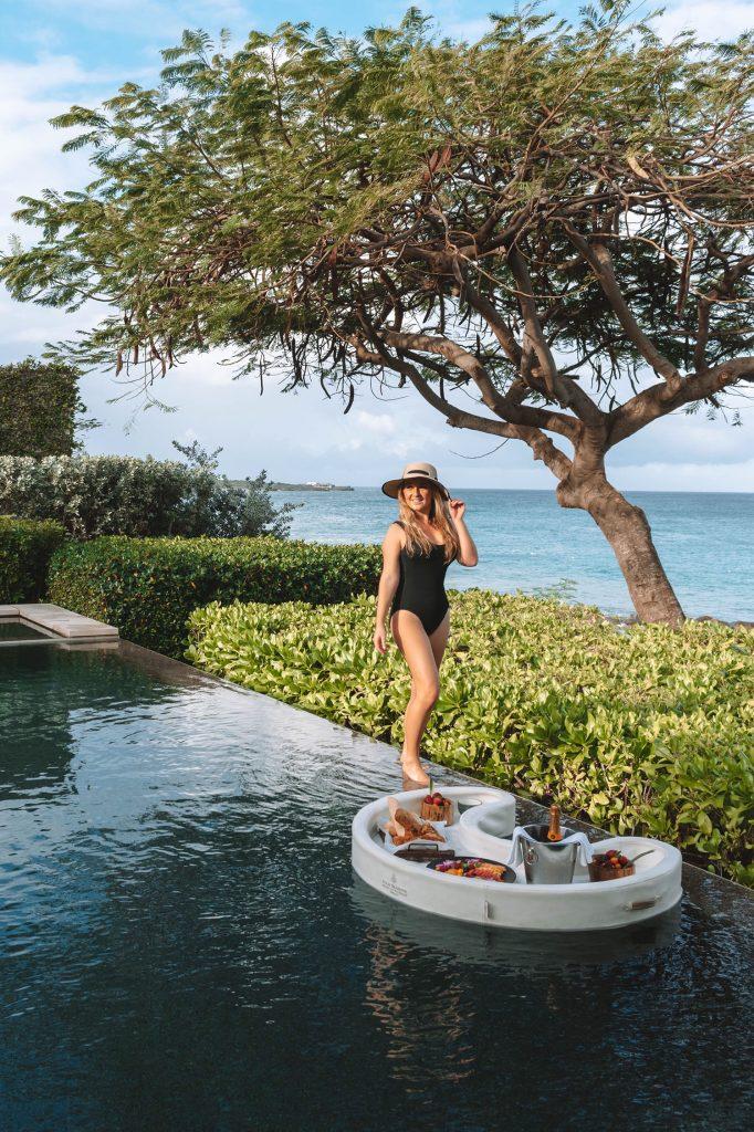 A woman enjoying a breakfast poolside at Four Seasons Anguilla
