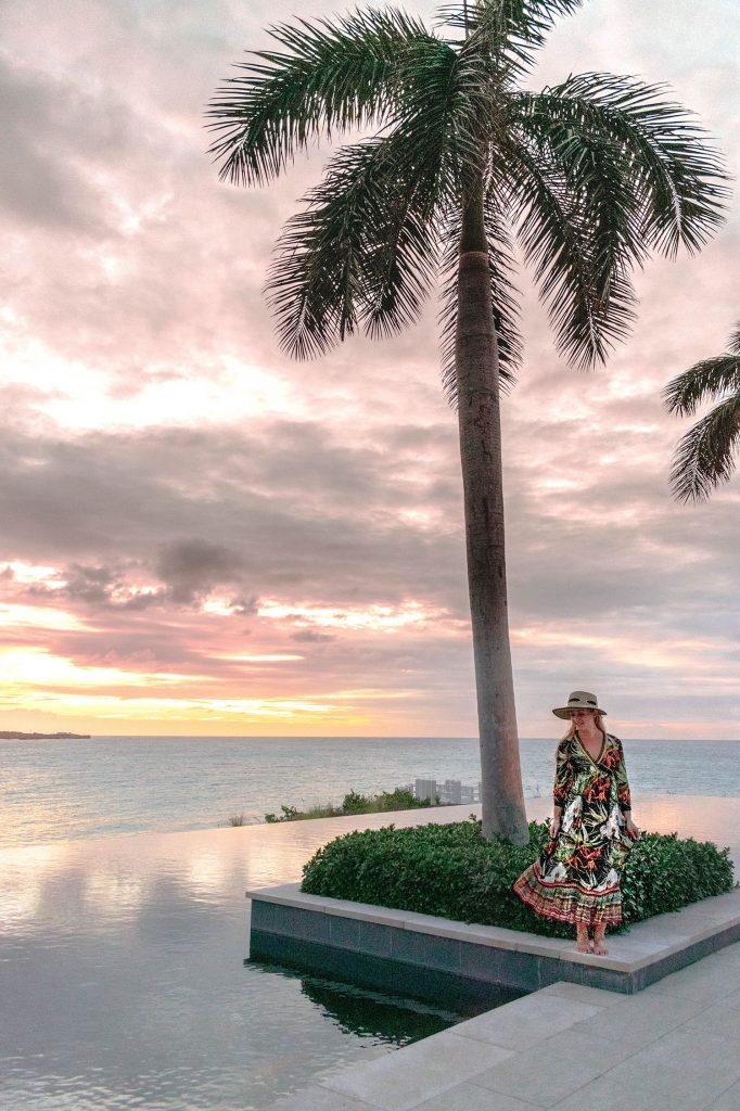A woman enjoying sunset at Four Seasons Anguilla