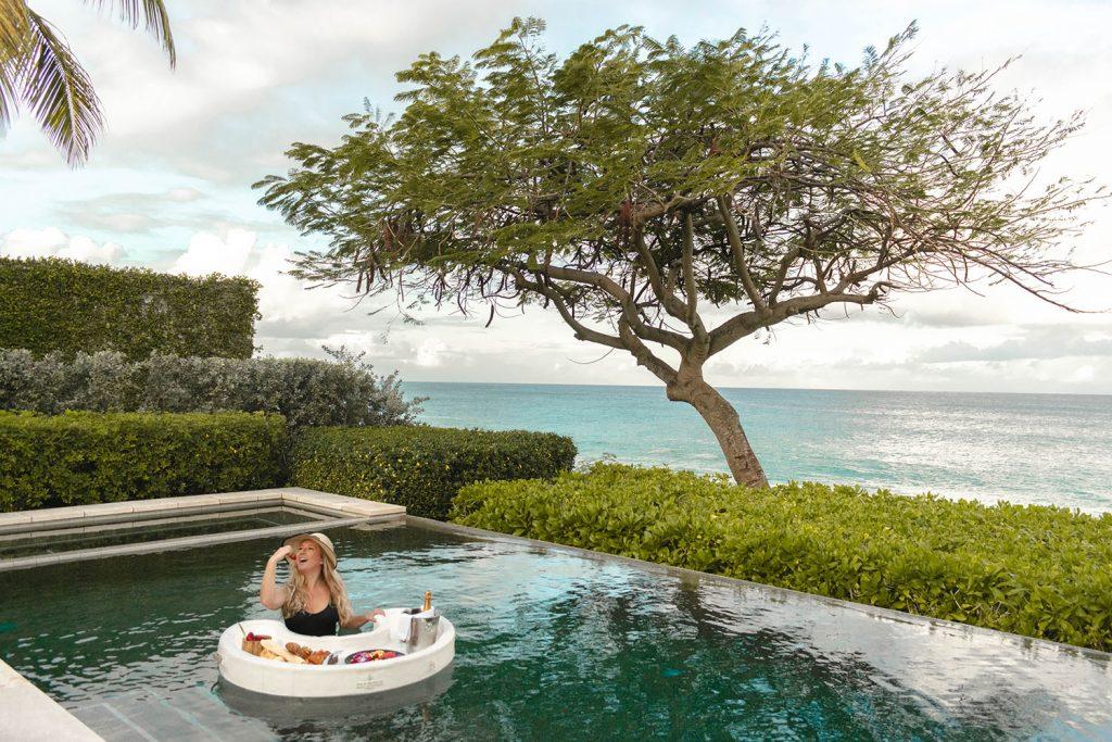 A woman enjoying a floating breakfast at Four Seasons Anguilla