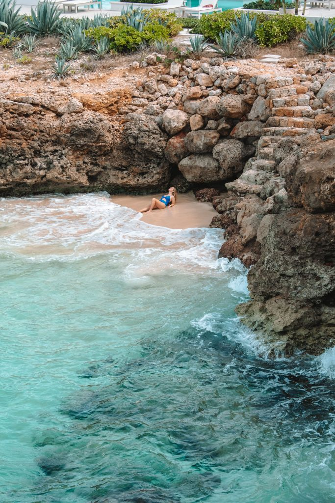A woman in one of the coves at Four Seasons Anguilla