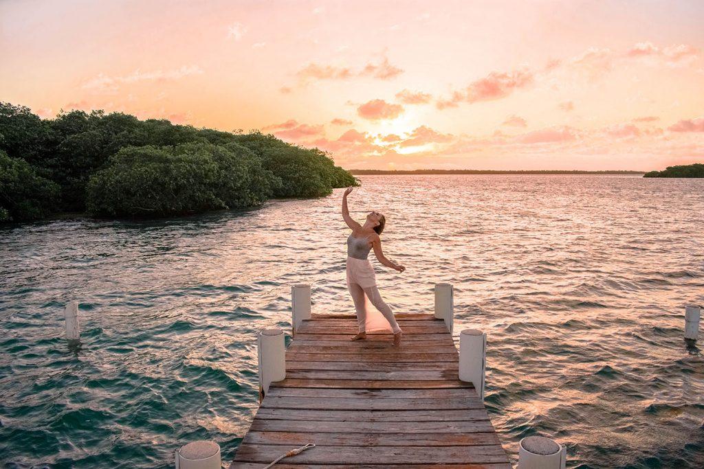A woman enjoying a sunset at Turneffe Island Resort in Belize