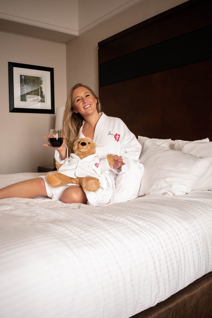 A woman holding a teddy bear during her one day and nigh at Hotel 43 in Boise