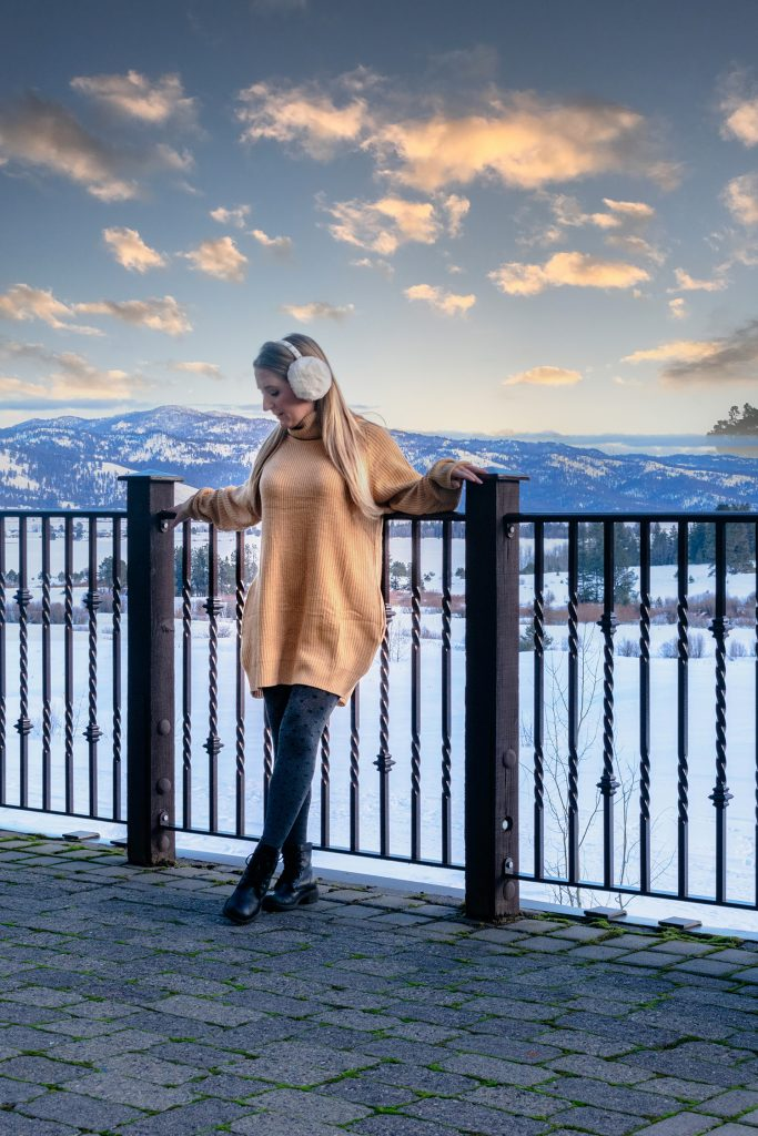 A woman enjoying a lovely winter trip at Tamarack Resort in Idaho