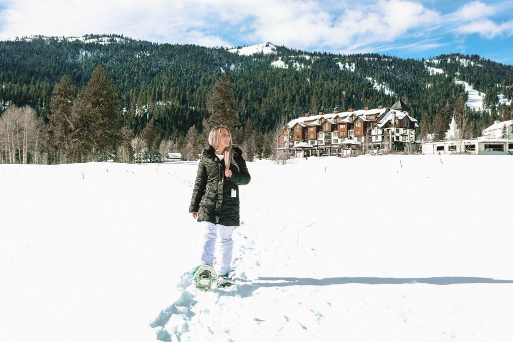 A woman snowshoeing at Tamarack Resort in Idaho