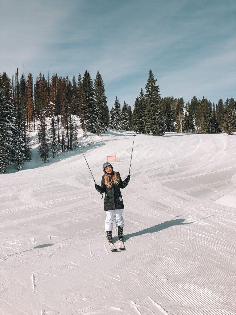 A woman skiing at Tamarack Resort in Idaho