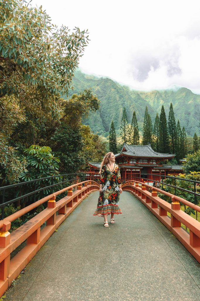 A woman admiring the peacefulness at Byodo-In Temple on Oahu, which is part of a 10 day Oahu and Maui itinerary