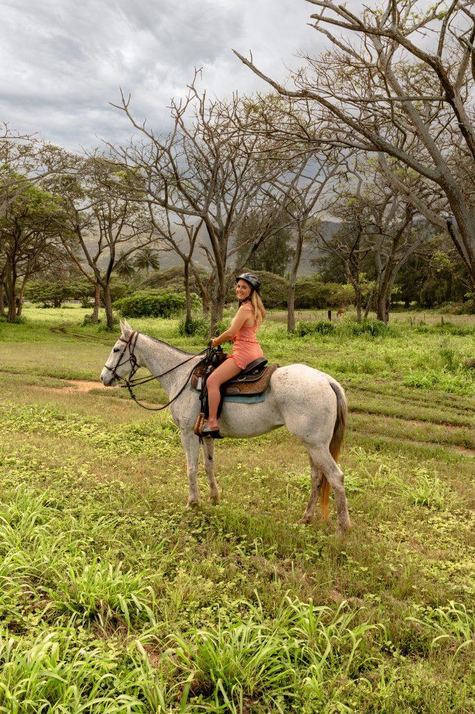 A woman horseback riding at Hawaii Polo Club on the North Shore