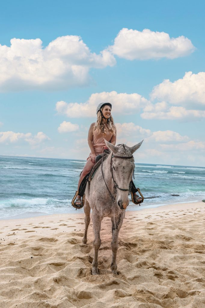 A woman horseback riding on the North Shore of Oahu, which was part of a 10 day Oahu and Maui itinerary