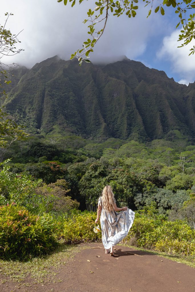 A woman at the botanical gardens on Oahu, which was part of her 10 day Oahu and Maui itinerary